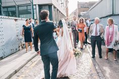 Dancing in the Street | Blush Pink Wedding Dress Tamsin by Catherine Deane For A Stylish London Wedding At 06 St Chads Place With Images From Robbins Photographic