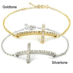 @Overstock.com - Sparkling Sideways Cross Bracelet with Extension - A curved cross highlighted by glittering crystals are the hallmark of this inspirational chain bracelet with extension. It is available in silvertone and goldtone and is fastened by a toggle clasp.  http://www.overstock.com/Jewelry-Watches/Sparkling-Sideways-Cross-Bracelet-with-Extension/7010821/product.html?CID=214117 ZAR              211.00