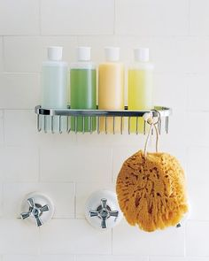 Uniform Bottles - Uniform plastic bottles not only look better than the usual shampoo and soap containers, but they also fit more neatly in storage devices, such as the hanging wire basket installed in this shower stall. It's always helpful to identify bottles with laminated labels, adding either the names of family members who prefer their own products or else listing the contents of the containers.