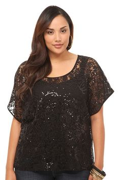 Floral+lace+sprinkled+with+dazzling+sequins+forms+the+front+of+a+trend-right+dolman+top.+We+love+layering+with+sheer+pieces+this+fall+and,+with+eye-catching+shine,+this+top+practically+demands+to+be+worn.