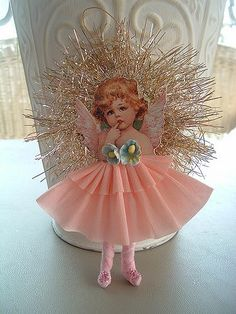https://flic.kr/p/4NFSp4 | wee fairies 049 | This is a victorian style ornament, with a spun cotton body, crepe paper dress and vintage forget me not flowers. My original design. Can be found on thepinktulip.etsy.com  My website: thepinktulip.net