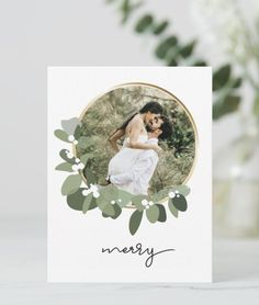 """Minimalist Christmas card design with a modern font for """"Merry"""" The beautiful gold ring is delicately decorated with eucalyptus green leaves and white flowers. Personalize the names, greeting, address and photo with your own. Perfect for newlywed couple's and their first christmas Married! Minimalist Christmas, Modern Christmas, Christmas Photos, Christmas Ideas, Holiday Cards, Christmas Cards, Beautiful Gold Rings, First Christmas Married, Eucalyptus Wreath"""