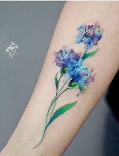 Magdalena Bujak watercolor flower tattoo