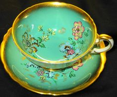 PARAGON ART DECO BUTTERFLY GOLD WIDE TEA CUP AND SAUCER TURQUOISE