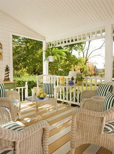 Porch at Harbour Cottage Inn, Southwest Harbor, Maine. Love the woodwork details and furnishings in this space.