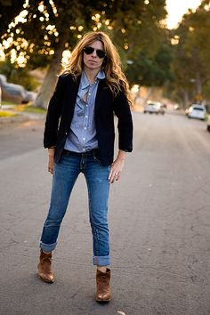 Somehow she looks rocker and preppy at the same time.  Is it the hair? The sunglasses?  The DIY cut-off cowboy boots?