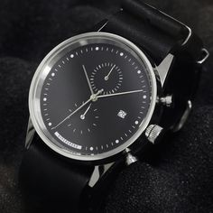 The Hypergrand Maverick Chrono Black leather has a black dial that contrasts with polished hands, a white index and a three o'clock date window.
