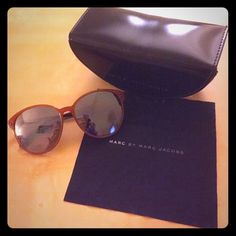 Marc by Marc Jacobs Sunglasses Model # MMJ 202/S 0C514 Color: Orange Nut/Brown Grey Lenses/Mirrored lenses. Oversized lenses.  Size: 56 mm Bridge: 15 mm Temples:135mm Authentic. No scratches. It is in very good condition. Very lightweight frames. Comes with case and cleaning cloth. Selling them because I want different style sunnies. Marc by Marc Jacobs Accessories Sunglasses