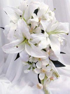 Tiger Lily's I love, add some purple. Bridesmaid bouquet