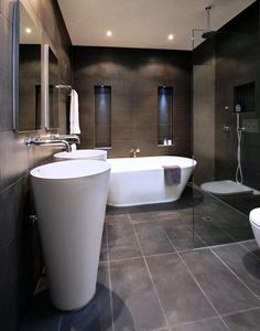 Never thought i would like a dark bathroom but: Neil & Jackie styled one of their bathrooms with quite dark interiors. Here's another idea of how you van design your bathroom with dark colours, but still make it seem really inviting and chic Dark Gray Bathroom, Dark Bathrooms, Wet Room Bathroom, Master Bathroom, Cosy House, Kb Homes, New Toilet, New Home Builders, Dark Interiors