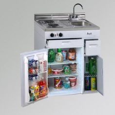 """COMPACT KITCHEN: This complete all-in-one kitchen unit by Avanti is designed to take up a minimal amount of space with a """"plug and play"""" simple approach to installing. It has a fridge, two burners, storage drawers and built-in backsplash. This kitchen solution will fit nicely into the smallest of kitchens."""