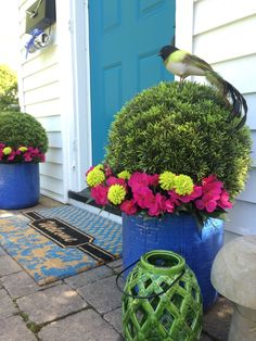 """Nothing says """"Welcome"""" like a bright inviting home entrance. Spruce up your front door this Summer with colorful planters, decorative lanterns, mats and garden accessories from HomeGoods. Sponsored Happy by Design"""