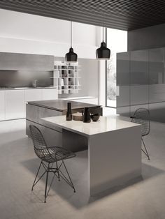 Modular Kitchen with a combination of glossy white lacquered counter and cement finished elements.