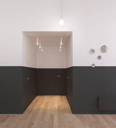 Porta verniciata in bianco e nero - interno appartamento stile nordico