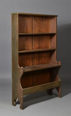 An American Painted Pewter Cupboard, 19th century, with three graduated shelves, with cut out ends and bootjack legs, in old original green paint, 67 H. x 40 W. x 12 D.