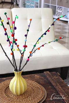 Pom pom branches are a quick and easy craft anyone can make! Get the full tutorial from Crafts by Amanda.