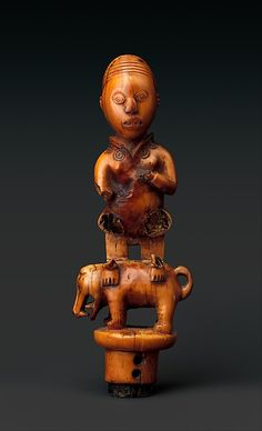 Staff Finial: Chief Seated on Dog Date: 19th–early 20th century Geography: or Cabinda, Angola, Republic of the Congo, Democratic Republic of the Congo Culture: Kongo peoples Medium: Ivory Dimensions: H. 8 1/4 in. (21 cm), W. 2 7/8 in. (7.3 cm), D. 2 in. (5.1 cm)