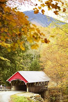 This covered bridge, in New Hampshire's Franconia Notch State Park, was built over the Pemigewasset River in 1886 // photo by Mark Read #newhampshire #newengland #usa #fall #fallfoliage