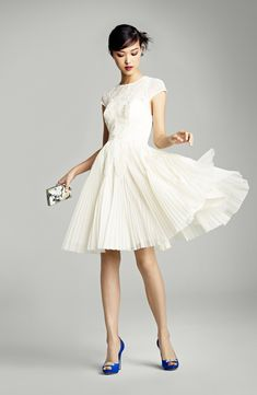 tea length vintage style Ted Baker Wedding Dress with those blue shoes and that teeny tiny bag