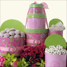 Our Spring Flowers Mothers Day Gift Tower is very chic and a perfect way to send warm wishes this Mothers Day. Three tiers of delicious gourmet treats will surprise, indulge and delight her. A perfect assortment is a stylish feminine gift box; send this delicious gourmet Mothers Day gift tower!  http://www.littlegiftbasketboutique.com/item_1109/Spring-Flowers-Mothers-Day-Gift-Tower.htm