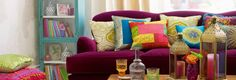 I like pillows for the pop of color and pattern...But who can sit on a sofa like that?