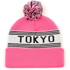 """A cuffed beanie featuring the text """"TOKYO"""" across and a small multi-colored pom pom on top."""