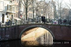 Guests in Amsterdam enjoy a walk around in the gorgeous winter morning light. Captured by Benjamin Arthur Photography