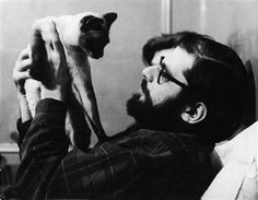 Allen Ginsberg & Siamese Cat at Home