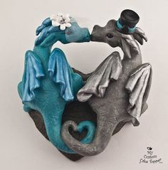 These adorable dragons are a unique cake topper and a beautiful keepsake from your special day.  You can select your accessories and the