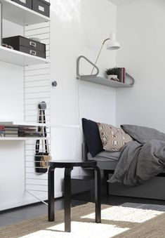 White String shelf, grey wall shelf and black stool from Artek Bedside Table Styling, Scandinavian Style Home, Scandinavian Bedroom, Interior Architecture, Interior Design, Interior Styling, Cool Rooms, Home Bedroom, Interior Inspiration