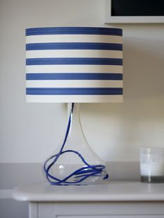 Why buy a new lampshade when you can make your own? Add a bright-pattered wallpaper to an old lampshade to give it new life.