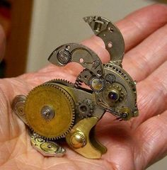 Susan Beatrice,  artist ~ made from recycled pocketwatch parts.