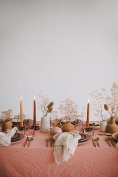 Blush tones and neutral florals with taupe candles on this tablescape – eakerikphotos.site