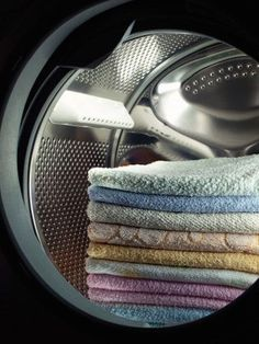 Save time and energy by throwing a dry towel into your dryer with your wet laundry. | 23 Surprising Laundry Tips You Didn't Know You Needed