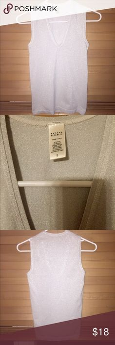 Gorgeous Silver, Sparkly Banana Republic V-Neck!! Like New (honestly dont know if i ever wore it!) Made in Italy, This Sparkly Silver (Color best Represented in Pics 2&4), Fitted, V- Neck Sleeveless Banana Republic Top is Excellent Quality 4an Amazing Price! Size Small, but the Material's Stretchy & Top is Meant 2b Fitted,So Id Say it'd Fit Sizes XS-M! No Stains, Rips,or Tears, No signs of Wear at all! Super Versatile-Perfect 4Work & Professional Events, Nitse Out w/Ur Girls, On a Date w/Ur…