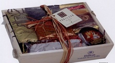 """Coffee Lover's Tray  Delicious assortment comes in an attractive wooden tray tied with natural raffia. Gourmet delights include: 2 oz. Bellagio Roast Coffee Gourmet Mocha Packet Natural Coffee Candies in tin Chocolate Wafer Cookies Chocolate Biscotti. 10"""" L x 8.25"""" W x 3"""" H"""