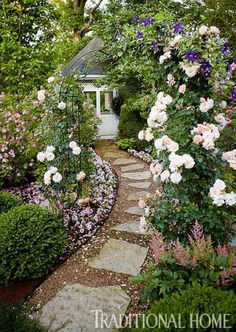 Rose arbor with stone path.  Path has some kind of black edging.  Classic Mother-Daughter Garden | Traditional Home