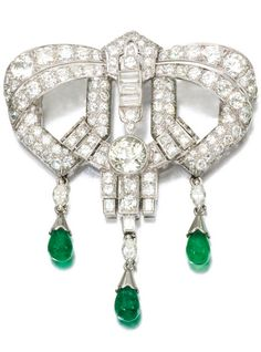 Emerald and diamond brooch, 1930s, composite. Designed as an openwork geometric…