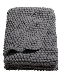 H&M blanket must have with blue duvet and a striped or pattern pillow