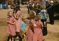 A family at the Vermont State Fair in September, 1941. It's so rare to see these early color photos, but they capture a true slice of life! Do you remember going to the State or County Fairs?