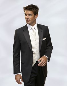 Eric will have a black tux with all ivory underneath and long tie just like this, and with a dark purple boutonniere