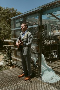 This sweet groom serenaded his bride-to-be before their first look with a special song he spent 4 years writing for her | Image by Katch Silva
