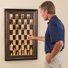 Amazing Vertical Chess Board - make a move as you walk in or out the door! Eli would love this:)
