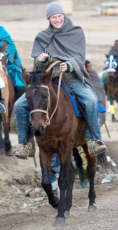 June 2010 - Prince Harry rides into Semonkong in Lesotho