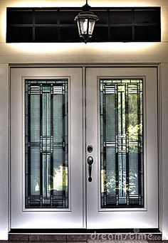 Double front door | HDR surreal photo image of a double front door with leaded glass on a ...