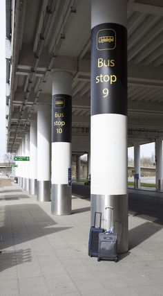 Column wrap signs at gatwick airport. www.stocksigns.co.uk
