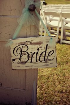 DIY Bride and Groom signs that my husband made with some left over wood and blue tool.