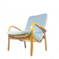 Stylish curved chair from Yngve Ekström Swedese with blue velvet cushion. In good original condition, with minor wear consistent with age and use. Pls ask for shipping quote before ordering.  Key Features: •Curved armrests. •Canvas back. •Blue velvet cushion.  http://www.retrorevolution.nl/furniture/191-yngve-ekstrom-swedese-chair.html