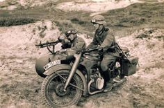 Soldiers with a BMW R35 and side car