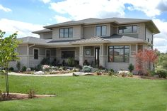 The transitional prairie style is perfect for this midwest location. Pinnacle windows by Windsor Windows and Doors.